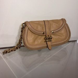 Juicy tan clutch, goes with everything!